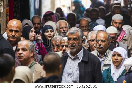 JRUSALEM OLD TOWN, ISRAEL - OCTOBER 31, 2014: Unidentified people return from Friday prayer on mount temple at al aqsa mosque. - stock photo