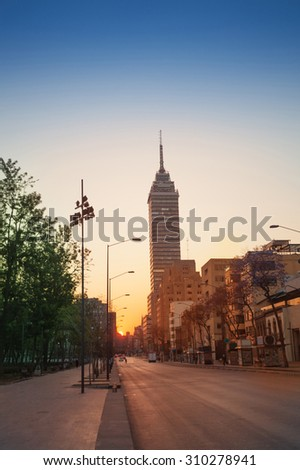 Juarez Avenue towards Latin America tower in Mexico downtown in sunrise summer sun - stock photo