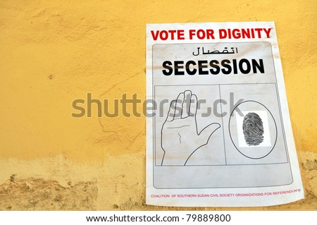 JUBA – JUNE 11: A poster remained on a wall in the capital Juba on June 11, 2011. Southern Sudan NGOs campaigned for secession ahead of a referendum for independence held in January 2011. - stock photo