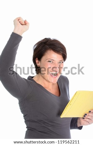 Jubilant attractive woman rejoicing the news she has just received in a letter in a brown envelope - stock photo