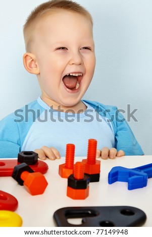 Jubilant children with toys - stock photo