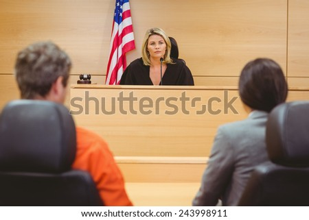 Judge and lawyer discussing the sentence for prisoner in the court room - stock photo