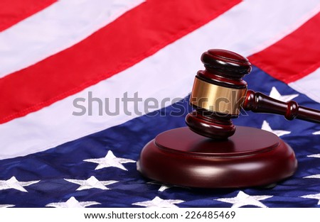 Judge Gavel and American Flag - stock photo
