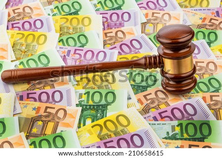 judge gavel and euro banknotes. symbolic photo for costs in court of law and auctions - stock photo