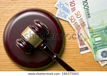 judge gavel and euro currency on wooden table - stock photo