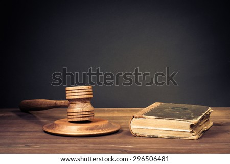 Judge gavel and law book. Symbol of justice. Old style filtered photo - stock photo