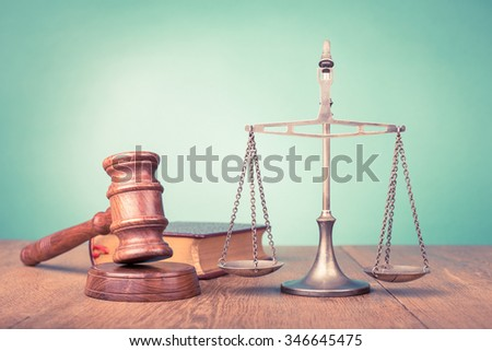 Judge gavel and low scales and book. Symbol of justice. Retro old style filtered photo - stock photo