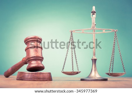 Judge gavel and low scales on table. Symbol of justice. Retro old style filtered photo - stock photo