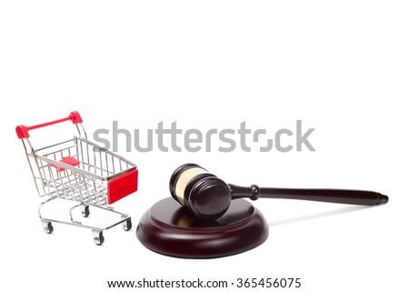 Judge gavel and shopping cart isolated on white background.  - stock photo