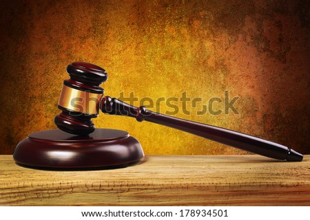 Judge gavel and soundboard on wooden table - stock photo