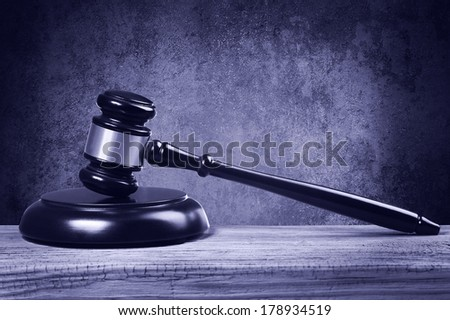 Judge gavel and soundboard on wooden table.  - stock photo