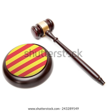 Judge gavel and soundboard with national flag on it - Catalonia - stock photo