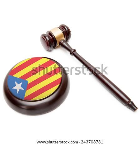 Judge gavel and soundboard with national flag on it - Estelada - Catalonia - stock photo