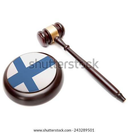 Judge gavel and soundboard with national flag on it - Finland - stock photo