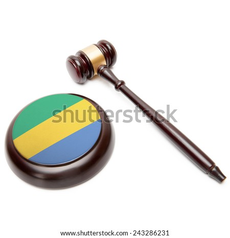Judge gavel and soundboard with national flag on it - Gabon - stock photo