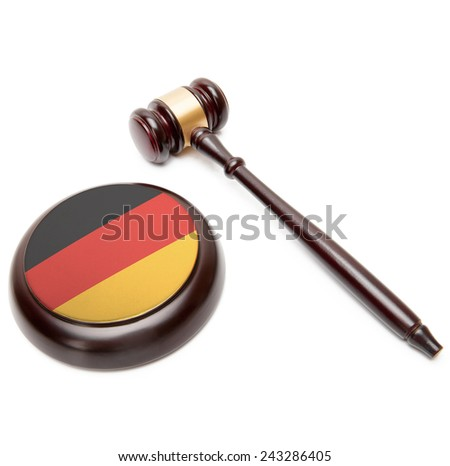 Judge gavel and soundboard with national flag on it - Germany - stock photo