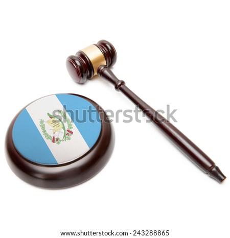 Judge gavel and soundboard with national flag on it - Guatemala - stock photo