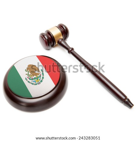 Judge gavel and soundboard with national flag on it - Mexico - stock photo