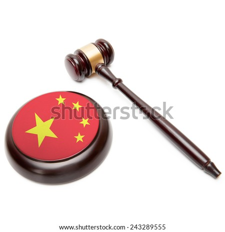 Judge gavel and soundboard with national flag on it - People's Republic of China - stock photo