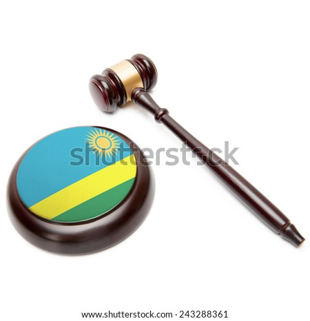 Judge gavel and soundboard with national flag on it - Rwanda - stock photo