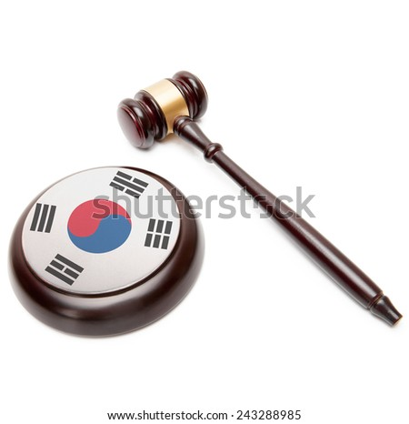 Judge gavel and soundboard with national flag on it - South Korea - stock photo