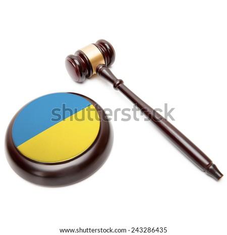 Judge gavel and soundboard with national flag on it - Ukraine - stock photo