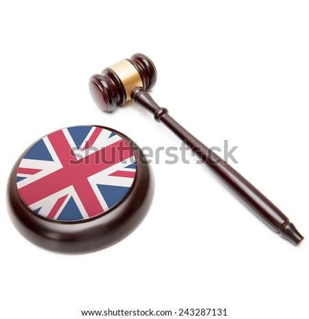 Judge gavel and soundboard with national flag on it - United Kingdom - stock photo