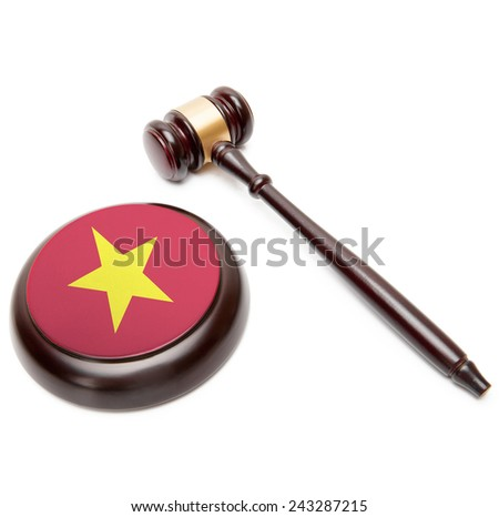 Judge gavel and soundboard with national flag on it - Vietnam - stock photo