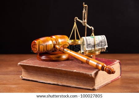 judge gavel, book and scales with money