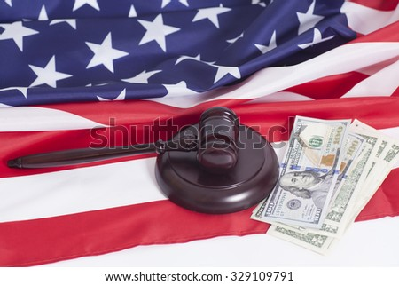 Judge gavel, Dollar banknotes and American flag - stock photo
