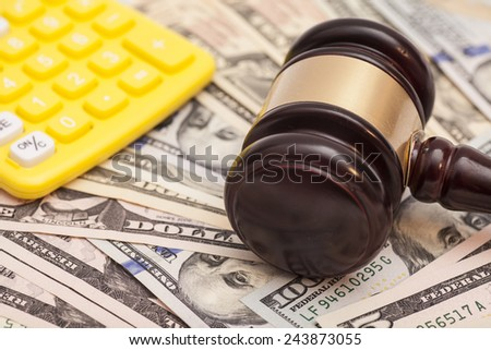 judge gavel,dollar banknotes and calculators  - stock photo