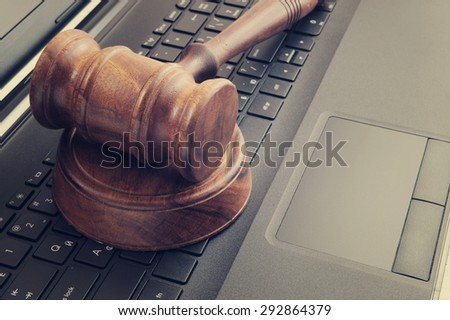 Judge gavel on laptop computer, cyber law or crime concept - stock photo
