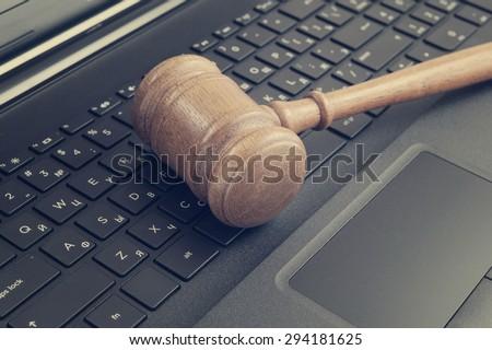 Judge gavel on laptop keyboard - stock photo