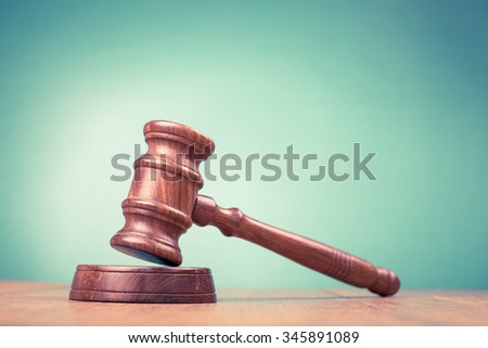 Judge gavel on table. Symbol of justice. Retro style filtered photo - stock photo
