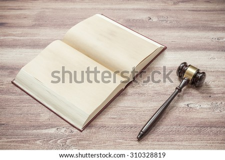 judge gavel on the brown wooden table,justice - stock photo
