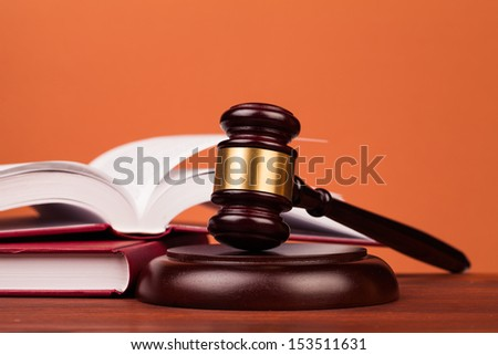 judge gavel on wooden table - stock photo
