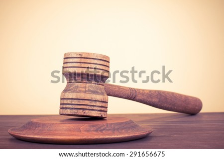 Judge gavel on wooden table. Symbol of justice. Retro style filtered photo - stock photo