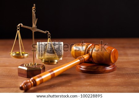 judge gavel scales with money - stock photo
