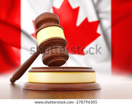 Judge Gavel with Canadian Flag on background - stock photo