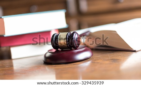 Judge gavel with law books - stock photo