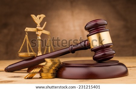 judge gavel with money  and scales closeup - stock photo
