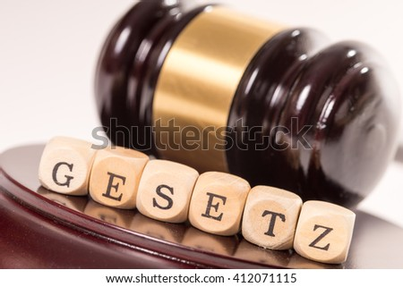 judge gavel with wooden letters and the german word law / Law - stock photo