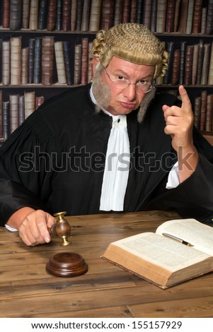 Judge giving a criminal a warming after his decision - stock photo