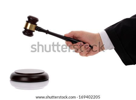 Judge hitting gavel giving his verdict - stock photo