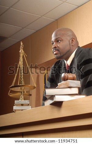 Judge listening closely in the courtroom - stock photo