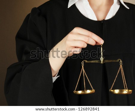 Judge on black background - stock photo