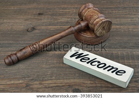 Judge Or Auctioneer Gavel And Sign Welcome On Grunge Wood Background, Top View - stock photo
