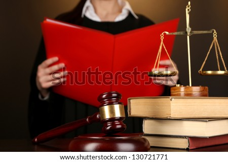 Judge read verdict on brown background - stock photo