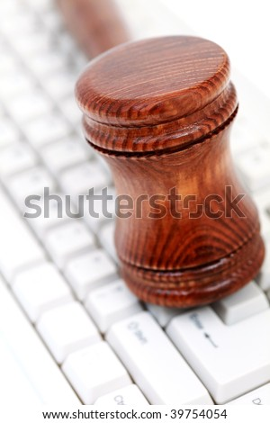 judge's courtroom gavel on computer keyboard - stock photo