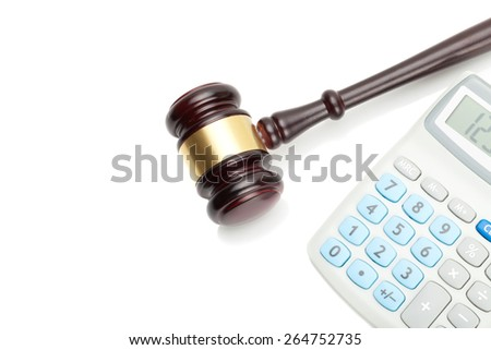 Judge's gavel and calculator next to it - stock photo